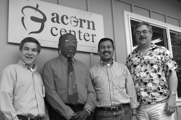 Pastors Marc, Josue, and Steve with John Perkins Outside Acorn Center